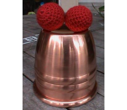 Brass cup and woolen balls
